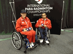 Paula Robinson and Owen Kilburn picking up the bronze medals